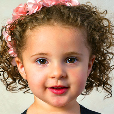Curly hair toddler at a Preschool & Daycare Serving Williamsburg, VA