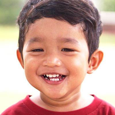 happy little asian boy smiling at a Preschool & Daycare Serving Williamsburg, VA
